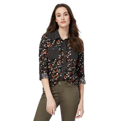 Black floral and polka dot print shirt