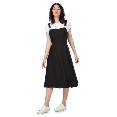 Black buckled pinafore dress