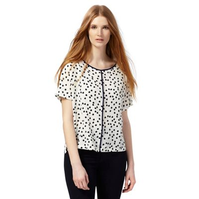 White scratchy spot cut-out back top