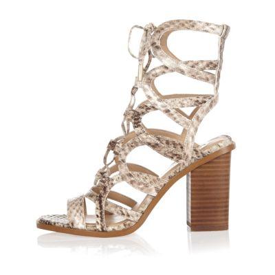 Beige snake print caged block heel sandals
