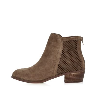 Beige perforated faux suede ankle boots